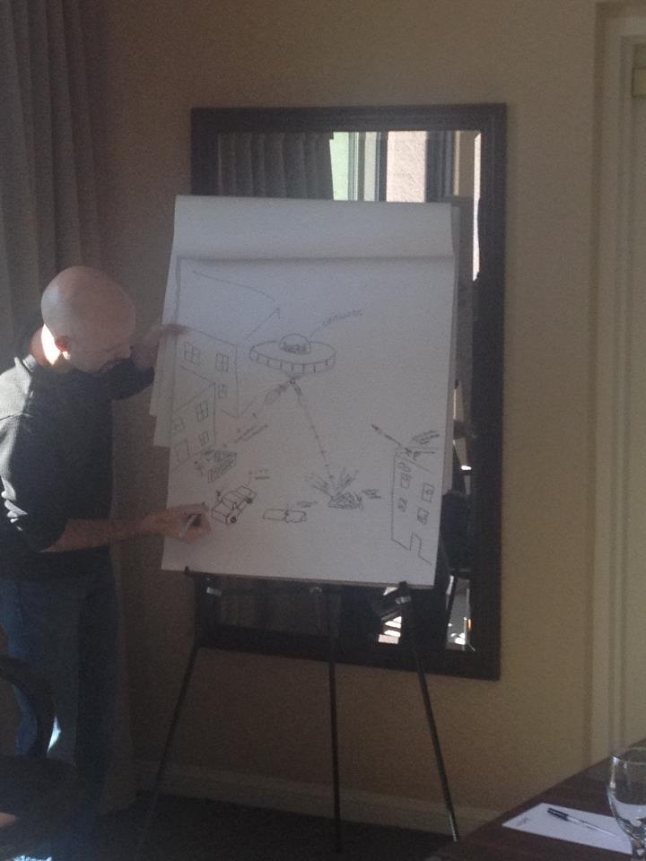 """""""Colin is seen here busily working on his martian invasion map."""""""